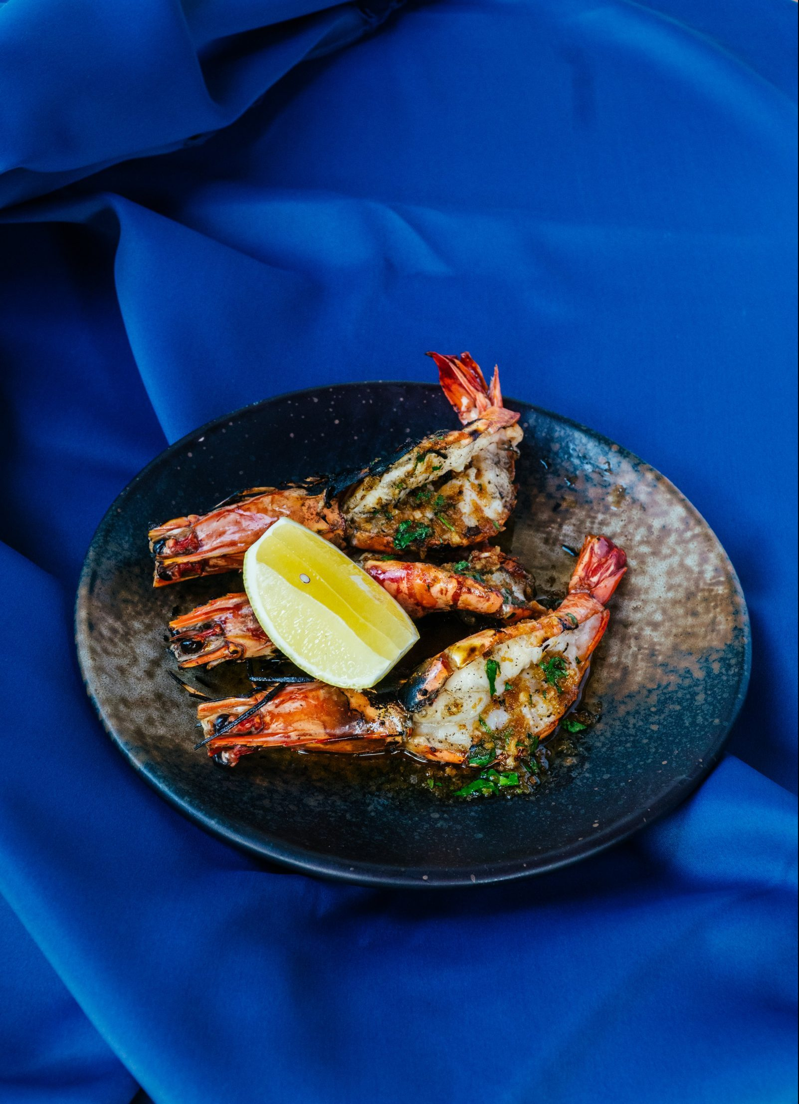 Grilled tiger prawns with herb butter