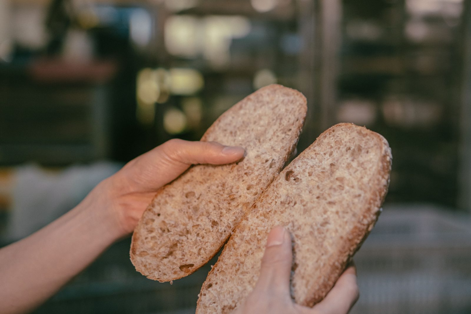 Nick showing us the crumb inside his sprouted wheat loaf.