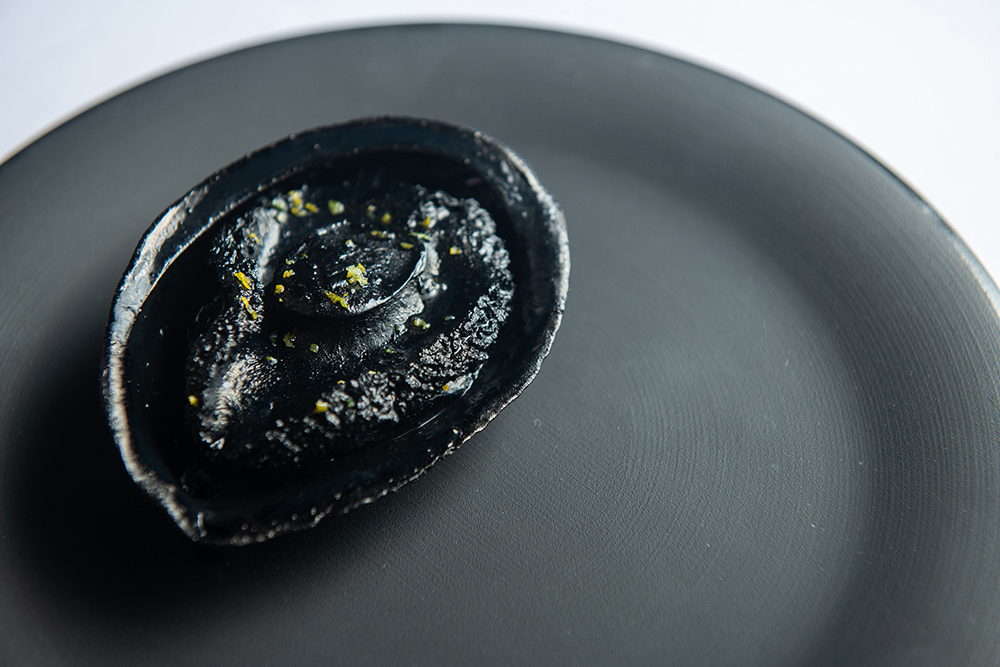 Local abalone infused with natural sweetness from its meat and liver, dressed with squid ink sauce
