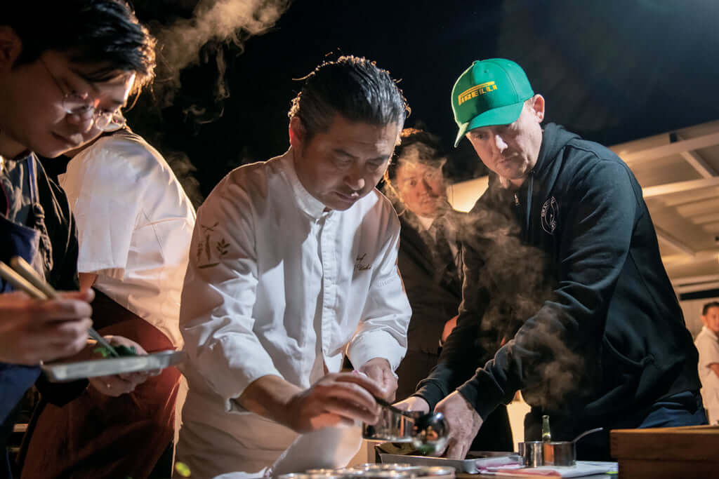 Chef Masahito Ueki and Chef Joshua Skenes plating food for the diners