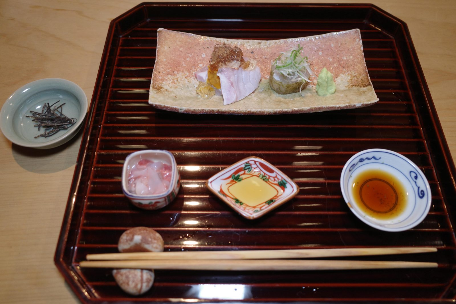 Appetisers including mahata with uni, and shiroebi kelp on the side