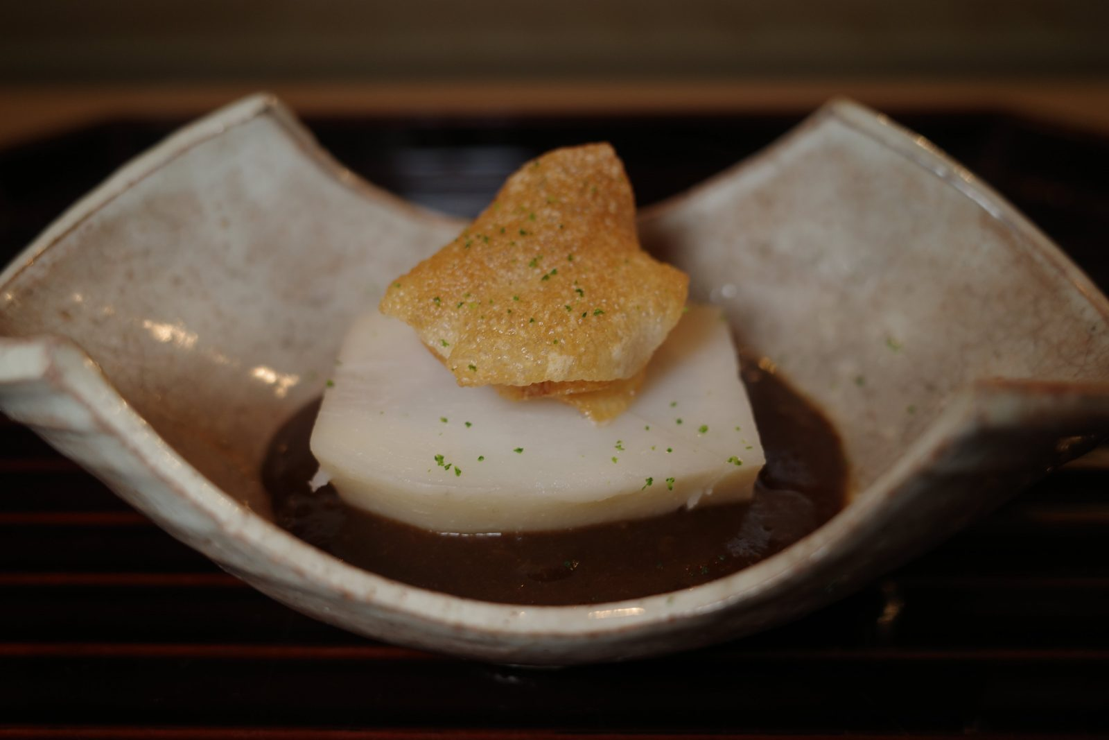 Local satoimo (Japanese taro) with ginger miso sauce, topped with saitoimo chip
